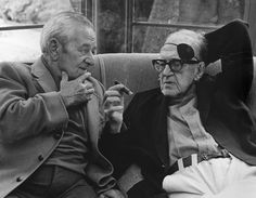 John Ford talking to William Wyler at a George Cukor hosted lunch for Luis Bunuel