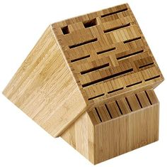 Shun 22-Slot Bamboo Knife Storage Block by Shun. $89.95. Natural beautiful, laminated bamboo with a clear finish. Includes a slot for a cleaver and slots for steak knives. Nonskid rubber feet. Block has 22 knife slots plus slots for shears and a sharpening steel. Safely and securely houses the cutlery. 22-slot storage block is made from bamboo; an abundant, renewable resource.