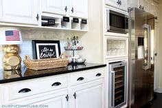 wine fridge with cubby for glasses above. I love the white/black too.