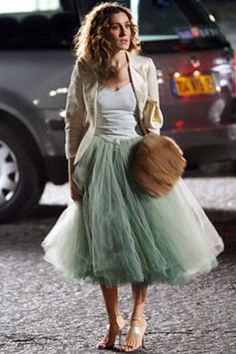 Sarah Jessica Parker as Carrie Bradshaw in a mint tulle midi skit, white tank top, and cream blazer. Yep, I would like this.