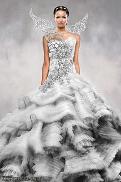 """Katniss Everdeen Mockingjay wedding dress.Bodice consist of Swarovski-crystal-clad organza corset under a metal cage"""