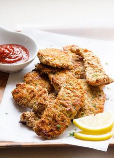 Baked Almond Chicken Strips -- A clean eating version of chicken strips that are baked instead of fried, and coated in ground almonds in place of breadcrumbs.