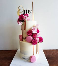 💕There ain't much cuter than turning one 💕 Semi naked two tiers with caramel drip, pink flowers, macarons and gold topper Macarons, Macaron Cake, 25th Birthday Cakes, Birthday Cake Girls, Tiered Birthday Cakes, Two Teir Cake, Elegant Cake Design, Birthday Cake With Flowers, Dream Cake