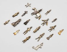 A collection of nineteen Spanish Colonial white metal pendants, 18th/19th century, modelled as diminutive human figures, one as rider on horseback, 6cm-3cm high Provenance: Lot 24 Sotheby's 1st April 1968 - Price Estimate: £120 - £180