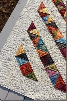 """Use 4 charms and a 9 1/2"""" neutral to create this great quilt of Split HTSs."""