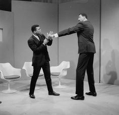 Basketball star Wilt Chamberlain extends a long left in the direction of world heavyweight champion Muhammad Ali as they met at an ABC television studio in New York, March 10, 1967. Chamberlain stands 7 feet, 1 inch tall, and Ali is 6 feet, 2 inches tall. Chamberlain's reach is over 90 inches, Ali's is 79 inches. Their proposed fight, in all seriousness, never came off.