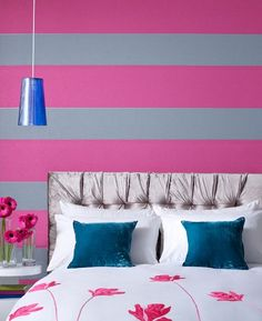 Pink and grey wallpaper by Graham & Brown in this bedroom