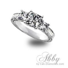 If you love our princess-cut stones then you will love them even more in our Abby engagement ring! This ring features princess-cut stones accented with antique engraving. From now until the end of June this ring is only $700.00 plus FREE shipping! To order our Abby call 1-800-682-0581 or visit http://www.lab-diamonds.com/abby-lab-created-engagement-ring.html