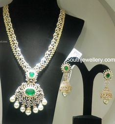 Stunning diamond necklace sprinkled with shimmering diamonds, emeralds and south sea pearls teamed with attractive diamond emerald jhumkas from Malabar Gold and Diamonds. Related PostsDiamond Pendant and Jhumkas SetDiamond Necklace and Jhumkas SetPeacock Diamond JhumkasDiamond JhumkasDiamond Ruby JhumkasBeautiful Diamond Jhumkas