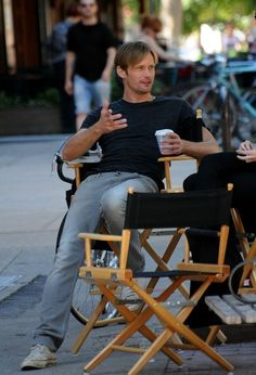 Alexander Skarsgard drinks a cup of coffee in between takes on the set of his…