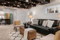 Your basement ceiling is the ideal place to experiment. Here are eight basement ceiling ideas that will help you capitalize on a major interior opportunity. Low Ceiling Basement, Dark Basement, Basement Living Rooms, Basement Lighting, Rustic Basement, Modern Basement, Basement House, Basement Flooring, Living Room Remodel