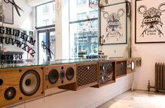 Hustle and Blow - hair salon in NYC.  I love the counter made of old speakers.