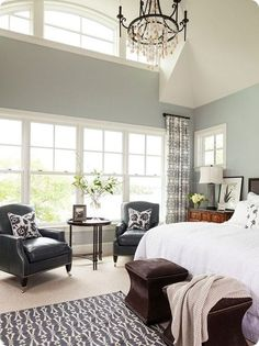 light blue walls, white bedding