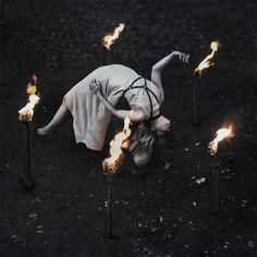 """The Offering"" — Photographer: Amy Ballinger Dress/Harness: Lauren Roberts - Haus of Elle Torch Maker/Assistant: Jon Derke Model: Cristina Peterson"