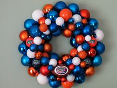 man i would love to make this but for the broncos. help me find orange ornaments please!!!!!    FLORIDA GATORS UF 2 Ornament Wreath. $59.00, via Etsy.