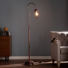 Light up just the right spot in your living space with the Southern Enterprises Terrance Floor Lamp . This industrial-inspired floor lamp features a. Industrial Floor Lamps, Industrial Chic, Industrial Revolution, Bronze Floor Lamp, Contemporary Floor Lamps, Modern Contemporary, Lamp Shade Store, Pipe Lamp, Street Lamp
