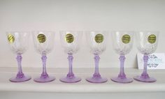 SOLD by NBV - more vintage finds added daily. Set of 6 genuine lead crystal stem glasses $48, made by Cristal D'Arques (France), gorgeous lilac stems, excellent condition, still in original box with original stickers in place. Glass measures 11 cm tall.