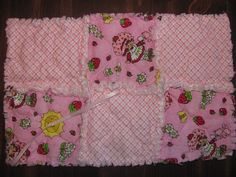 This is a Handmade rag quilted Strawberry Shortcake Inspired binkie/pacifier holder / Burp Cloth. This measures 9x14 is made with Strawberry