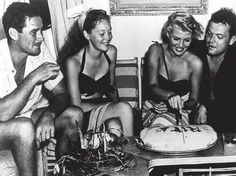 Errol Flynn and his wife Nora Eddington with Rita Hayworth and Orson Welles