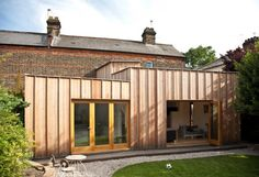 timber cladding against brick