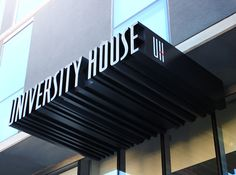 The 18-story towers' main entrance is identified with a flush mounted neon blade sign. Extruded lettering marks the entrance while creating an awning over the doors.