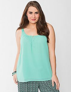 Boasting flirty femininity for the season, this gorgeous woven tank is a must for the sunny days ahead. Double-layered woven tank features charming grosgrain ribbon straps and a scoop neckline with buttoned keyhole detail. Versatile style dresses up for the office or down for weekend fun. lanebryant.com