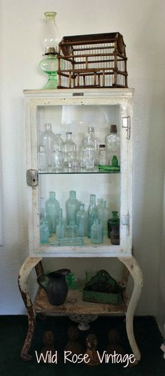 Wild Rose Vintage ~ Vintage medical cabinet with old medicine bottles