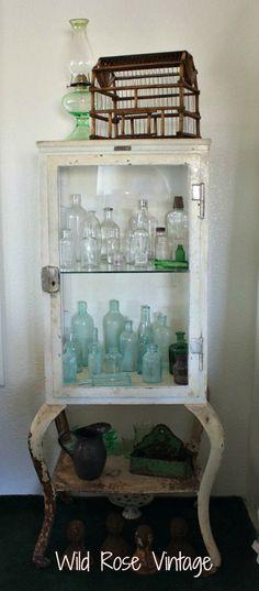 Wild Rose Vintage ~ Vintage medical cabinet with old medicine bottles