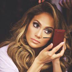 It's J.Lo. I like the make up job.