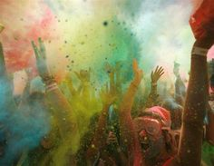 South African revellers covered in coloured cornflour powder during the Holi One festival, Cape Town