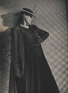 Woman Wearing Mainbocher Coat ca. 1938 — Model wearing polka-dotted swing-shaped coat by Mainbocher, crepe dress with ruched cummerband waist, strands of pearls, and low-crowned boater with two featherlike ornaments by Talbot Vintage Fashion 1950s, 40s Fashion, White Fashion, Art Deco Fashion, 1930s Costumes, Horst P Horst, Victorian Hairstyles, Vintage Fashion Photography, Vintage Coat