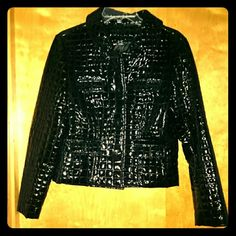 New designer Joseph A. Black PU leather jacket New without tags Joseph A. designer faux patent leather black jacket. Look sexy in this glossy faux snake skin jacket wherever you go. Fully lined with a hidden inside breast pocket made with pretty purple and black fabric.....see last picture. Four buttoned pockets in front. Jacket has a four button closure. Comes with extra button Joseph A. Jackets & Coats