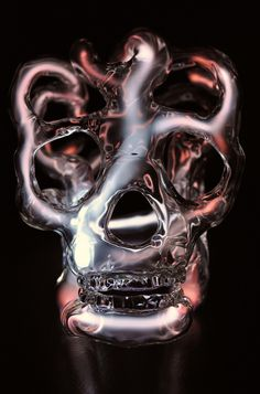 glowing neon skulls by Eric Franklin - filled with ionized neon, krypton, and mercury