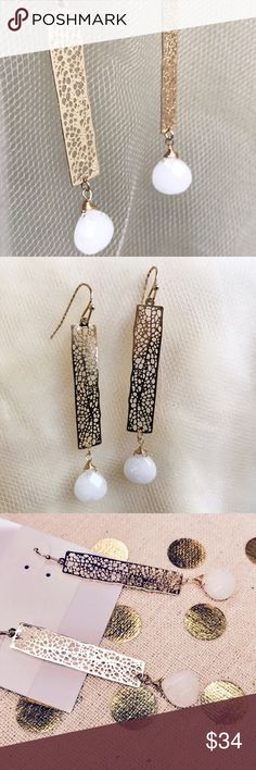 "Gemstone bar cut out earrings Gold tone earrings with intricate cut outs, finished with a faceted white stone. .4""x2.5""  Fish hook backs. Stunning! Farah Jewelry Jewelry Earrings"
