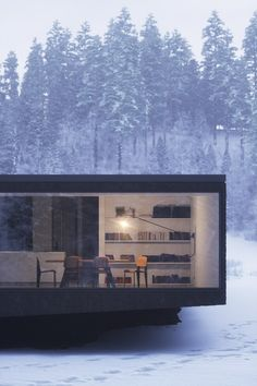 stark minimal black house. winter. home. cube. modern. contemporary. design. architecture.