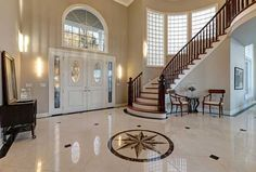 Stunning Two Story Entry Foyer With Marble Mosaic Tiled Floor Stock Photo - Imag. Stunning Two Story Entry Foyer With Marble Mosaic Tiled Floor Stock Photo – Image of foyer, mosai Concrete Staircase, Curved Staircase, Staircase Design, Flooring Companies, Flooring Options, Flooring Sale, Plank Flooring, Laminate Flooring, Cleaning Marble