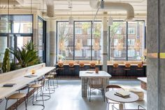 A variety of seating areas have also been incorporated in Bermonds Locke's reception so that it can serve as a co-working space. Where possible, the studio has tried to repurpose construction materials that otherwise would have been destined for landfill, influenced by the ad-hoc building methods used when creating cabins across Joshua Tree. Tower Bridge London, Sunny California, Banquette Seating, Studio Room, Hotel Interiors, London Hotels, Swinging Chair, Commercial Design, Innovation Design