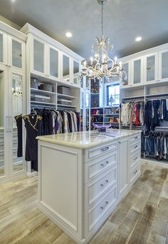 This extra tall custom closet organizer by #closetfactory maximizes the height of the walk-in closet and in style. The room features a two-sided island, open and closed hanging sections and a top layer of closed storage cabinets to store seasonal items. Each aspect is custom designed and installed to suit the owner's wardrobe needs.
