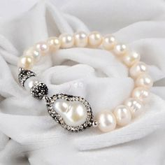 Fresh Water paved Pearl Stretch Bracelet Fresh Water paved with white CZ Natural Pearl Stretch Bracelet. Jewelry Necklaces