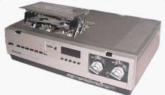 VCR.  Bought my first around 1985.  Cost about $400.  Had to pay to belong to a store that would rent you tapes.