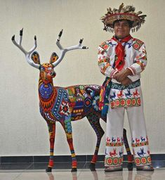 Huichol Man in embroidered clothing with a life sized beaded deer, Nayarit, Mexico נαηιєк∂єѕιgηѕ Mexican Folk Art, Mexican Style, Mexican Crafts, Peru, Chile, Deer Statues, Latino Art, Mexican Dresses, Mexican Clothing