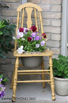 Chair full of pansies! Great planter idea.