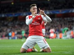 """Mesut Ozil hints at Arsenal stay by insisting he is """"happy"""" at Emirates"""