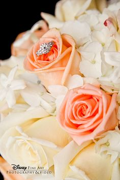 The only thing better than a gorgeous rose, hydrangea and stephanotis bouquet is finding a stunning ring inside #Disney #wedding #bouquet #ring #shot