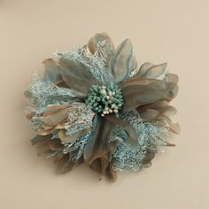How to Use Mint in a Winter Wedding | Shimmering Mint & Olive Hair Flower #bride #bridesmaid #wedding #hair