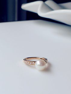 Beautiful ring presents perfect round flawless white pearl crowning graceful band set in gold with small diamonds. LOVE IT!