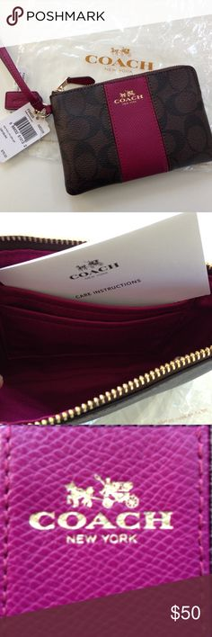 COACH Corner Zip Wristlet Signature Coach Corner zip Wristlet, Signature, brown with fuchsia leather stripe. Comes with all packaging. New with tags Coach Accessories
