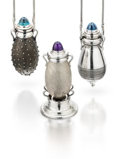 Amphorae Collection by Cyd Rowley.These pendants are hollow vessels with removable lids; each lid with a topaz or amethyst stone. The body styles vary. These are meant to be displayed as art pieces in the home when not worn