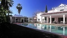 Villa for sale in Atalaya - Costa del Sol. This contemporary,modern styled, Private Villa is tastefully decorated and located on exquisite manicured grounds,in the heart of Estepona in the prestigious residential area of Atalaya Alta, Estepona,Spain