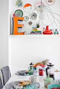 Complement neutral dining furniture with colourful accessories